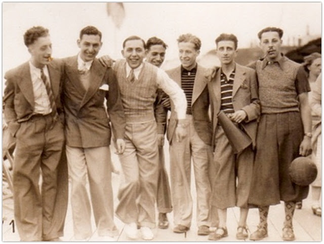 Seven guys wearing thirties-era casual menswear.