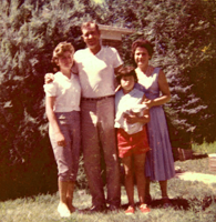 Family posed in yard